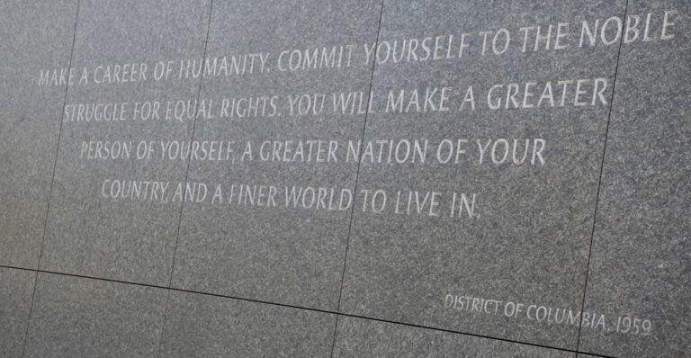 Dr. Martin Luther King Jr. Monument, grey stone with quote inscribed 'Make a career of humanity, commit yourself to the noble struggle for equal rights, you will make a greater person of yourself, a greater nation of your country, and a finer world to live in'