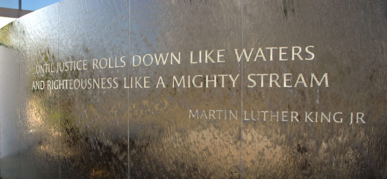 Dramatic quote from Dr King engraved on a wall